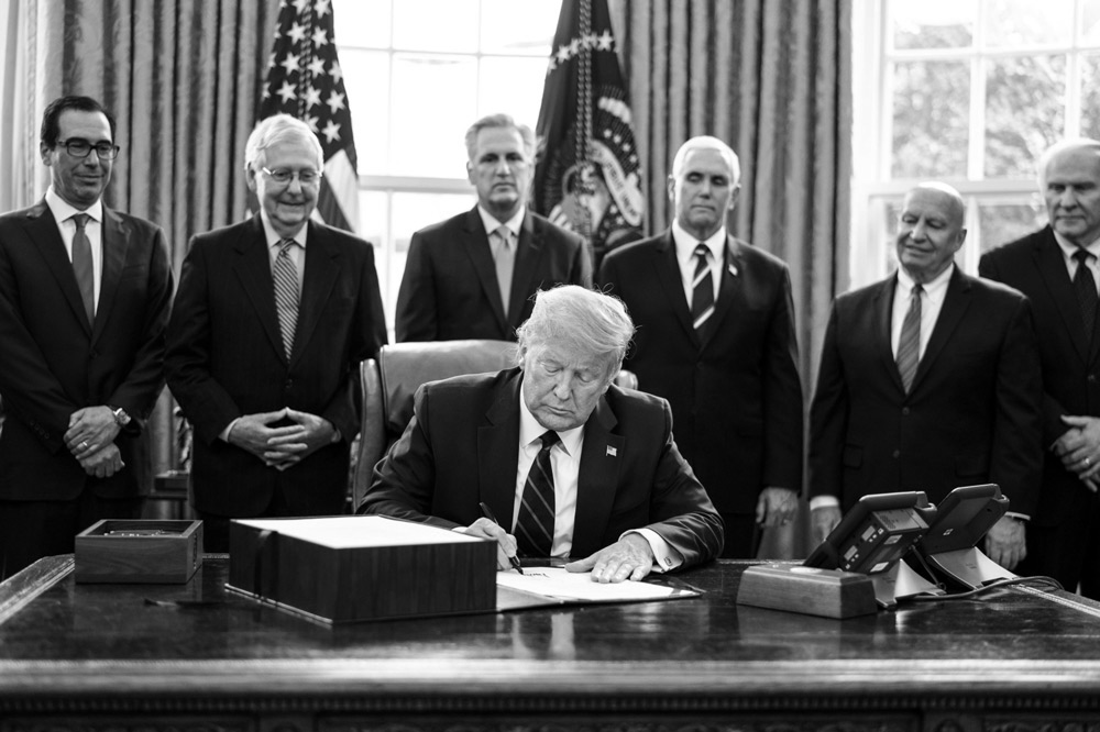 President Trump signs the H.R. 748, Coronavirus Aid, Relief, and Economic Security (CARES) Act (Erin Schaff/Bloomberg)